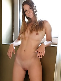 Vanesa vanesa flaunts her sexy, tight body as she strips on the bed.