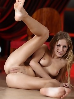 Uninhibited debutante spreads her legs to show off her flexible feet and sweet, ripe snatch.