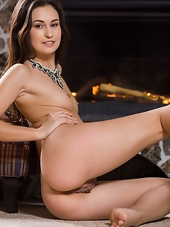 Lilian a alluring lilian a shows off her tight body and curvy hips as she strips by the fireplace.