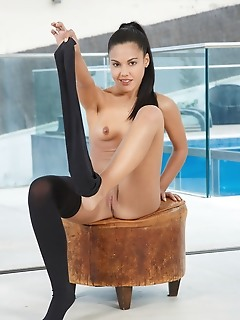 Apolonia apolonia spreads her legs wide open baring her delectable pussy.