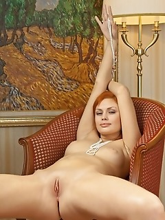 Charming redhead with smooth pale skin and supple assets.