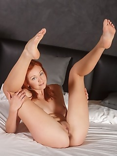 Elen moore redhead elen moore bares her smooth, pink pussy   and slender body on the bed.