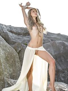 Nika n nika n sensually poses on the rocky mountain as she bares her sexy, tight body.