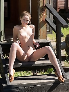 Faina bona youthful faina bona strips outdoors baring her meaty pussy.