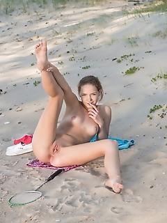Faina bona gorgeous faina bona flaunts her meaty cunt as she plays around the beach.