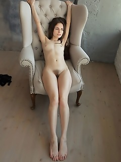 Sofi shane sofi shane playfully poses on the chair as she flaunts her hairy pussy.