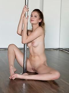 Dakota burd dakota burd displays her flexible, tight body as she streches on the pole.