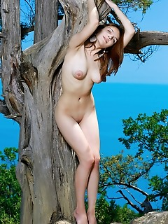 Olga rich olga rich poses by the tree as she bares her amazing titties and smooth cunt.