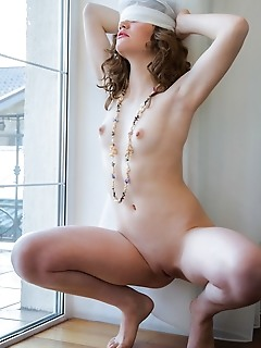 Carrie new model carrie bares her slender, nubile body with pink nipples by the window.