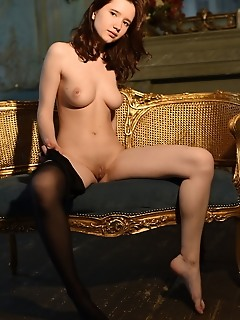 Lizette lizette spreads her legs wide open baring her small, meaty pussy on the couch.