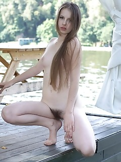 Victoriya a victoriya a poses and flaunts outdoors with her sensual and tempting poses that compliments her ultra-feminine body and unshaved bush