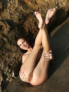 Galina a galina a poses at the beach baring her sexy, wet body.