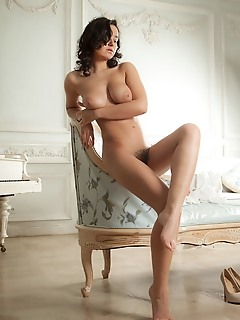 Sanita sanita shows off her large tits and hairy pussy on the sofa.