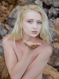 Nika n alluring blonde nika n flaunts her tight body at the rocky terrain.