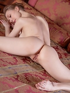 Annett a annett a bares her flexible body and perky nipples on the bed.