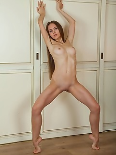 Nalina nalina displays her petite, flexible body as she stretches in front of the camera.