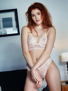 Adel c redhead adel c slowly strips on the couch baring her creamy body.