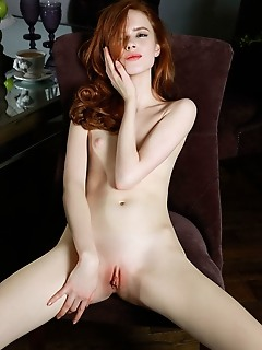 Bella milano sultry redhead bella milano wearing nothing but a black fishnet stockings